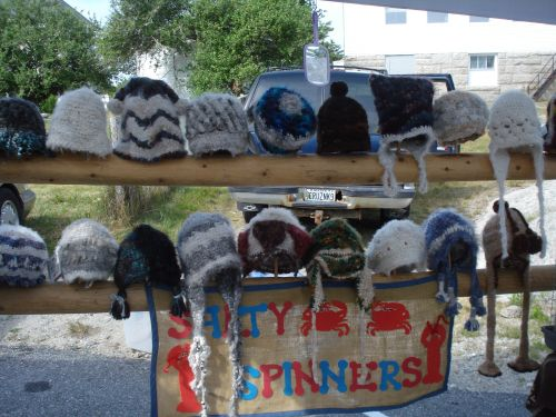 An array of gorgeous one-of-a-kind hand knitted hats from Salty Spinners