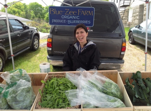 Blue Zee can sell you baby arugula while telling you about her trip to India.
